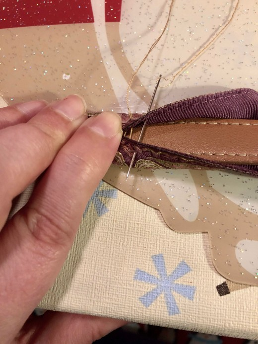 Sewing the tie on the strap